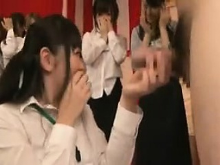 A band of chicks pose added to team a few gal is picked to suck on his