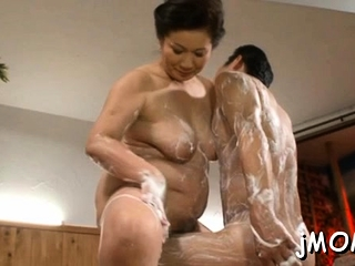 Large titted asian doyenne gets screwed hard in doggy position