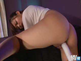 Pretty Azami in green shorts together with a tshirt has her pussy played with before she is toyed together with squirts